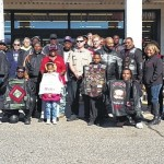 Bikers deliver in Toys for Tots ride